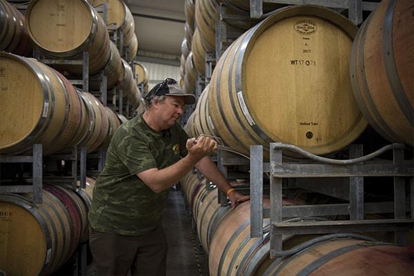 Man Inside a Wine Barrel Shed