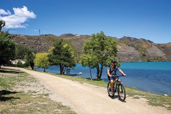 Man on Bike Next to Lake